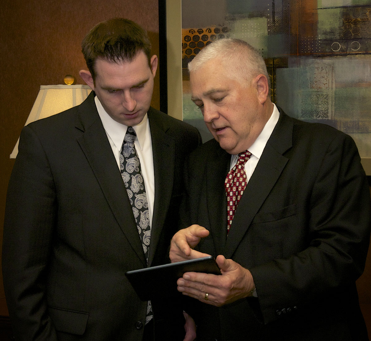 Photo of Dick Heidgerd and Eric Edwards reviewing a case together.